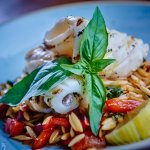 Chargrilled squid on a bed of chorizo pasta salad, chilli dressing