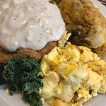 Country fried steak and scrambled eggs, with potatoes (good, but lots of butter).  Good value.