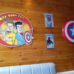 the comic book signs on the wall near to the window