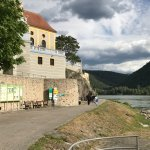 The base of the blue tower goes right down to the Danube
