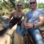 Enjoying Colombia a la horseback! Note: We only removed our helmets for a quick photo op.