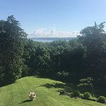 View from breakfast on the spacious back porch overlooking the yard and Hudson River