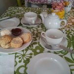 Sharing a pot of tea and scones with jam and clotted cream