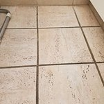 Black and dirty grout. Walk barefoot at your own risk.