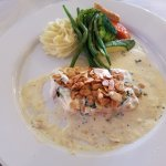 Red Snapper in wine sauce with roasted sliced almonds