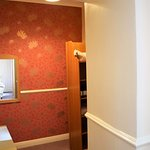 Step down into a small room as the closet & dressing room with a desk