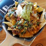 Try the Quickstop Nachos with Braised Beef. Amazing! And a little spicy.