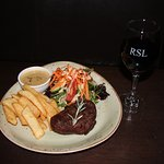 Gippsland eye fillet with mushroom sauce, beer battered fries and salad - our signature dish!
