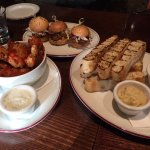 Pork sliders, hot wings and dips with Turkish bread.