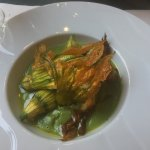 Stuffed courgette flowers with pea puree
