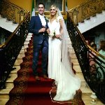 Our wedding Day photo on the staircase in Bridge House Hotel