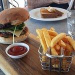 My burger & chips, husbands sandwich in background