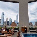 Crowded rooftop pool with a gorgeous view