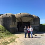 Viewing German battlement on our Normandy tour.