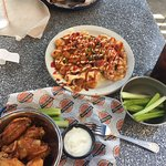 Wings w/ celery & blue cheese with loaded tots (cheese, onion, jalepenos, hot sauce). YUMMM