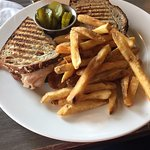 Turkey sandwich on sour dough with fries