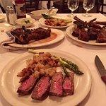 Sirloin steak mid-rare, double lamb chop, asparagus grilled, hash browns