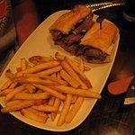 steak and bacon cheddaar cheese melt sandwich