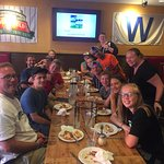 A group of happy customers after enjoying stuffed crust pizza