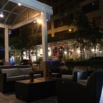 Front patio at night. Comfortable tables and chairs conducive to conversations and relaxing.