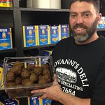 Owner, John, with homemade meatballs~ a local favorite!