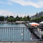 the waterfront in Geneva. Many restaurants and tourist shops line the promenade.