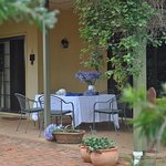 The verandah  overlooking farming and the garden, enjoy a BBQ, a coffee or a wine