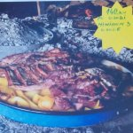 Traditional preparation of meat bellow the Peka