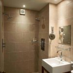 Hideaway bathroom with large shower heads