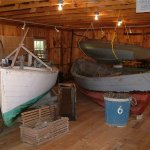 The boat shop displays boats, tools and fishing gear.