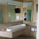 Wrap around mirror above the sinks