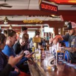 Make friends with locals and visitors. You never know who you'll sit next to at our bar.