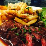 Duck fat fried with Parmesan cheese, skirt steak with a port/ red wine veal Demi sauce. Lunch at