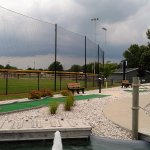 Partial view of ball diamond from mini golf course.