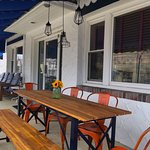 awning covered front porch offers al fresco dining
