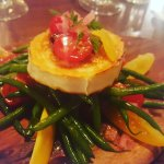 Pan fried goat's  cheese  with  green  bean  and  heritage  tomato.