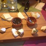 Cheese board with delicious local honey and jam