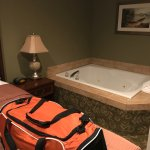 Double seated jetted bath tub in King size bedroom