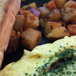 Cheese omelet w/ spinach, sundried tomatoes & capers served w/ homemade bread & home fries