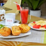 French toast with tropical fruits, coffee and waterlemon juice