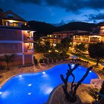 Evening Swimming Pool view with Exterior of Resort