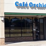 front of & entrance to Cafe Orchid