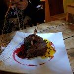 Exquisito postre mousse de chocolate y excelente la atencion del garzon un 7 en todo buenisimo