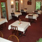 Dine at couple's tables; some group seating available