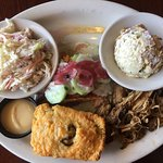 Smoked salmon and pulled pork, coleslaw, potato salad, corn bread