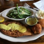 Pecan crusted grouper with green beans and hush puppies