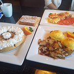 Eggs Benedict, home-style fries, Belgian waffle, french toast and bacon tomato cheddar cheese om