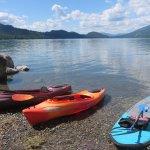 Kayaks and stand up board on Whitefish Lake