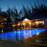 Sunshine Resorts property, pool and sunshine grill