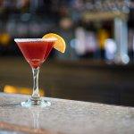 the oxford - taaka vodka, fresh lemon, pomegranate juice, champagne float, sugar rim